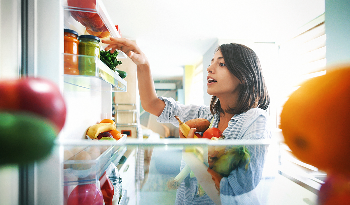 Woman grabbing food from the fridge
