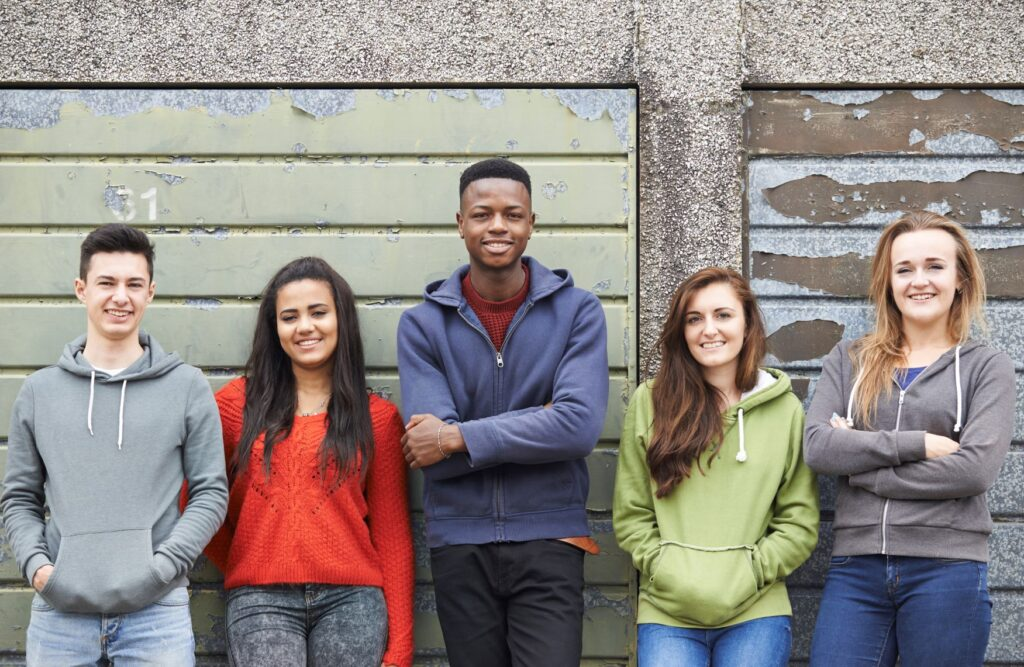 group of young people smiling learning to be aware of mental health